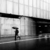 man with umbrella in the rainy streets of germany