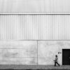 fine art street photography with a small human in front of architecture