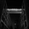 minimalist bridge between modern architecture builiding