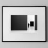 man in black suite between dark rectangles indoor modern street photography