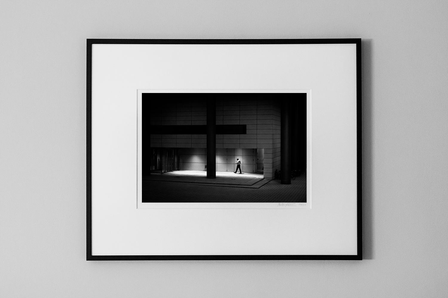 a man in interesting light in a building with a huge cross fine-art limited print street photography